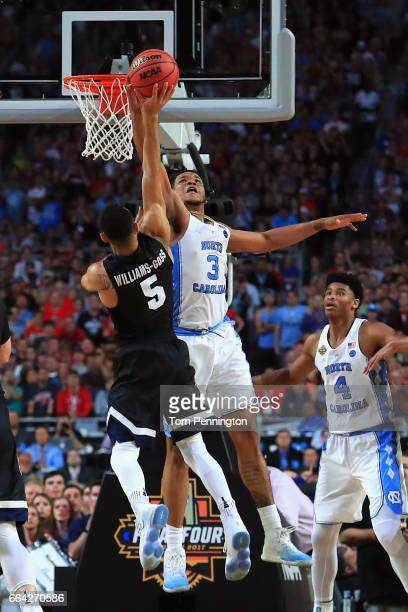 Kennedy Meeks of the North Carolina Tar Heels defends Nigel WilliamsGoss of the Gonzaga Bulldogs late in the second half during the 2017 NCAA Men's...