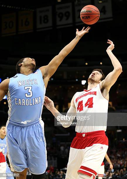 Kennedy Meeks of the North Carolina Tar Heels goes up for the ball against Frank Kaminsky of the Wisconsin Badgers in the first half during the West...