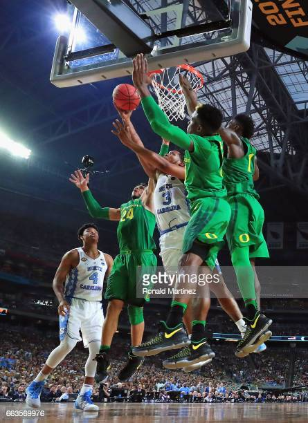 Kennedy Meeks of the North Carolina Tar Heels goes up with the ball against Dillon Brooks of the Oregon Ducks in the first half during the 2017 NCAA...
