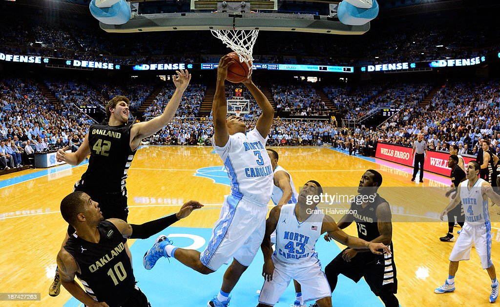 Kennedy Meeks #3 of the North Carolina Tar Heels pulls down a rebound against the Oakland Golden Grizzlies during play at the Dean Smith Center on November 8, 2013 in Chapel Hill, North Carolina. North Carolina won 84-61.
