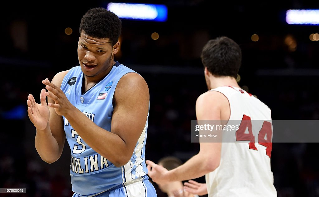 Kennedy Meeks of the North Carolina Tar Heels reacts in the first half alongside Frank Kaminsky of the Wisconsin Badgers in the first half during the...