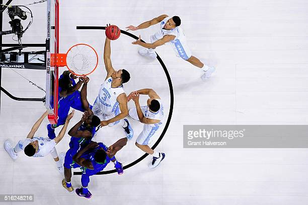 Kennedy Meeks of the North Carolina Tar Heels rebounds against the Florida Gulf Coast Eagles during the first round of the NCAA Men's Basbetball...
