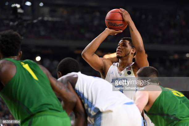 Kennedy Meeks of the North Carolina Tar Heels shoots a freethrow in the final seconds during the 2017 NCAA Men's Final Four Semifinal against the...