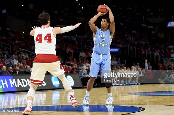 Kennedy Meeks of the North Carolina Tar Heels shoots over Frank Kaminsky of the Wisconsin Badgers in the first half during the West Regional...