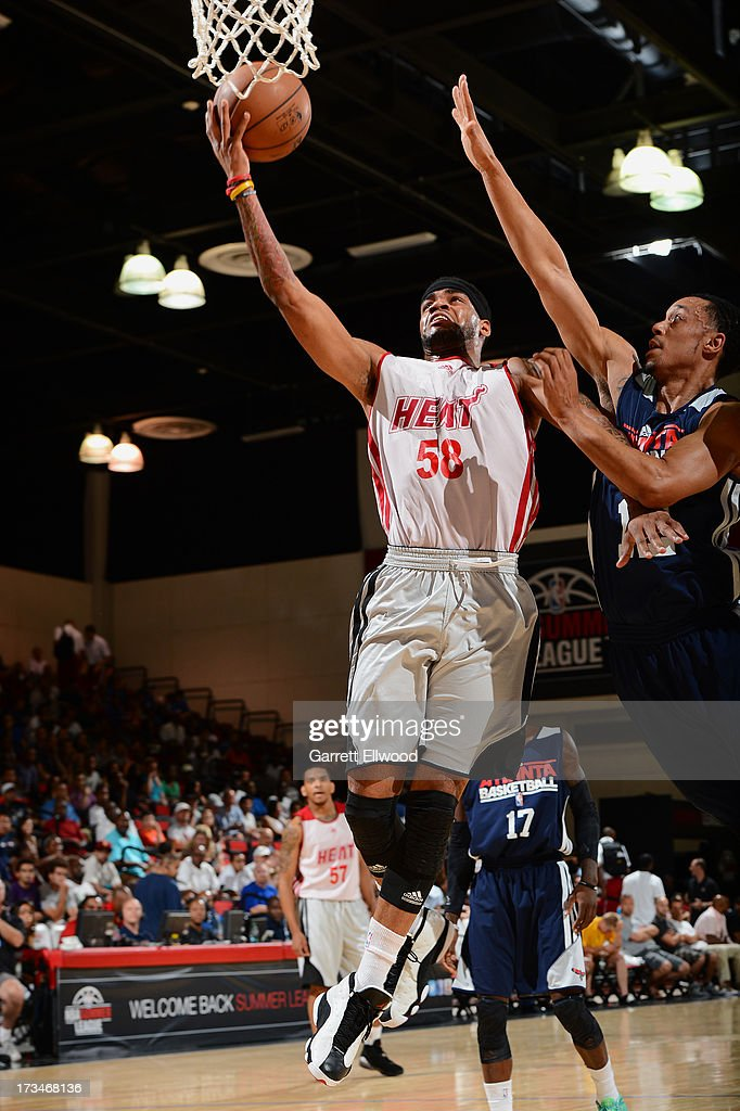 D.J. Kennedy #58 of the Miami Heat goes to the basket against John Jenkins #12 of the Atlanta Hawks during NBA Summer League on July 14, 2013 at the Cox Pavilion in Las Vegas, Nevada.