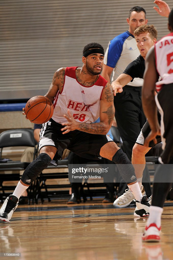D.J. Kennedy #58 of the Miami Heat looks to pass the ball pass against the Detroit Pistons during the 2013 Southwest Airlines Orlando Pro Summer League on July 12, 2013 at Amway Center in Orlando, Florida.
