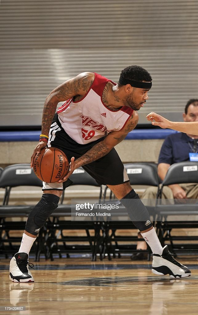 D.J. Kennedy #59 of the Miami Heat protects the ball during the 2013 Southwest Airlines Orlando Pro Summer League between the Detroit Pistons and the Miami Heat on July 12, 2013 at Amway Center in Orlando, Florida.