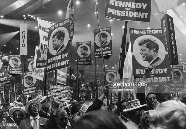 Kennedy supporters hold posters at the Democratic National Convention in Los Angeles California Their posters read 'A TIME FOR GREATNESS KENNEDY FOR...