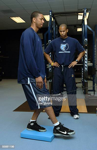 Kennedy Winston of the Memphis Grizzlies works with Mike Curtis strength and conditioning coach during Memphis Grizzlies Training Camp October 8 2005...