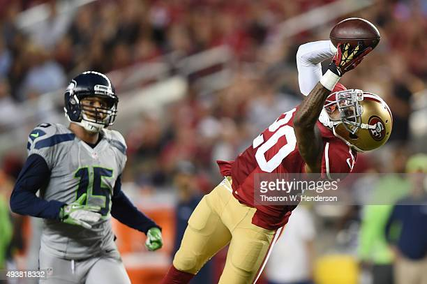 Kenneth Acker of the San Francisco 49ers intercepts a pass by Russell Wilson of the Seattle Seahawks in the third quarter of their NFL game at Levi's...
