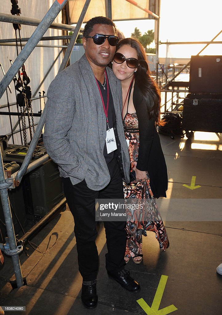 Kenneth 'Babyface' Edmonds (L) and Nicole 'Nikki' Pantenburg pose backstage at the 8th Annual Jazz In The Gardens Day 1 at Sun Life Stadium presented by the City of Miami Gardens on March 16, 2013 in Miami Gardens, Florida.