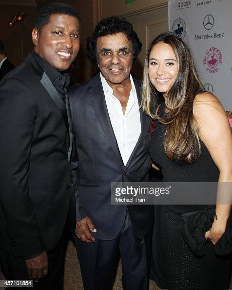 Kenneth 'Babyface' Edmonds Johnny Mathis and Nicole Edmonds attend the 2014 Carousel of Hope Ball held at The Beverly Hilton Hotel on October 11 2014...