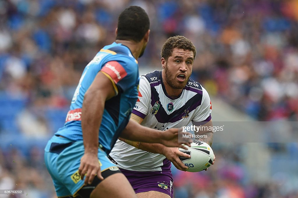 Kenneth Bromwich of the Storm runs with the ball during the round nine NRL match between the Gold Coast Titans and the Melbourne Storm on May 1, 2016 in Gold Coast, Australia.