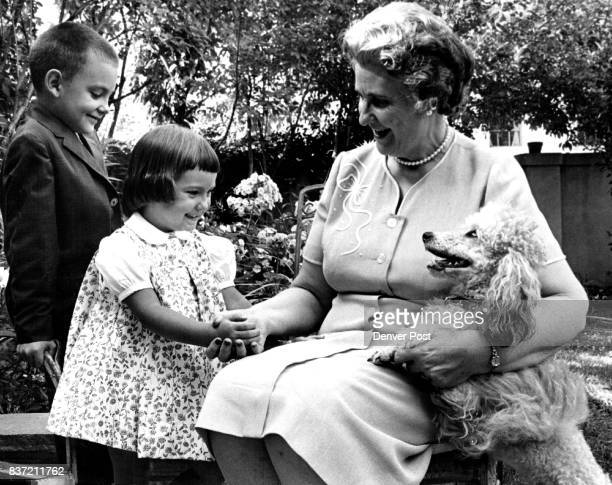 Kenneth C Sawyer III and Julia Ann Sawyer say hello to their grandmother Mrs Kenneth C Sawyer and her poodle in garden of her home Credit Denver Post