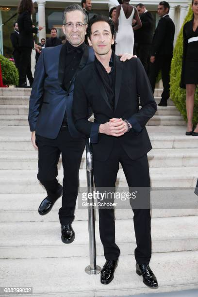 Kenneth Cole and Adrien Brody arrive at the amfAR Gala Cannes 2017 at Hotel du CapEdenRoc on May 25 2017 in Cap d'Antibes France