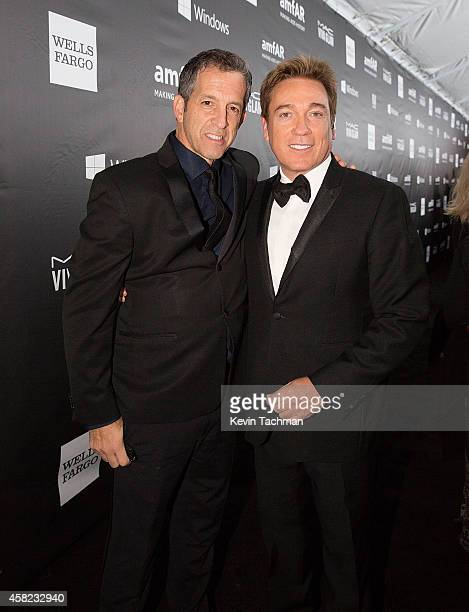Kenneth Cole and Kevin Huvane attend amfAR LA Inspiration Gala honoring Tom Ford at Milk Studios on October 29 2014 in Hollywood California