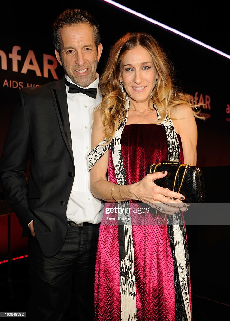 Kenneth Cole and Sarah Jessica Parker pose on stage the amfAR New York Gala To Kick Off Fall 2013 Fashion Week at Cipriani Wall Street on February 6, 2013 in New York City.