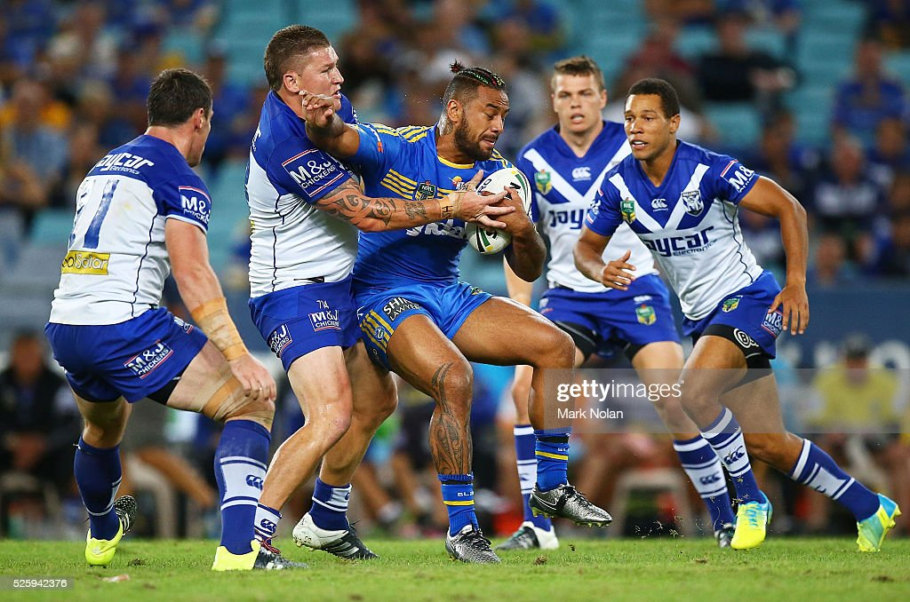 Kenneth Edwards of the Eels is tackled during the round nine NRL match between the Parramatta Eels and the Canterbury Bulldogs at ANZ Stadium on April 29, 2016 in Sydney, Australia.
