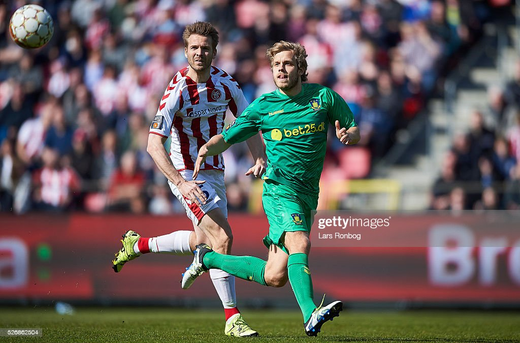 Kenneth Emil Petersen of AaB Aalborg and <a gi-track='captionPersonalityLinkClicked' href=/galleries/search?phrase=Teemu+Pukki&family=editorial&specificpeople=8055578 ng-click='$event.stopPropagation()'>Teemu Pukki</a> of Brondby IF compete for the ball during the Danish Alka Superliga match between AaB Aalborg and Brondby IF at Nordjyske Arena on May 1, 2016 in Aalborg, Denmark.
