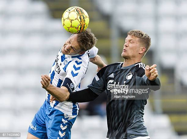 Kenneth Emil Petersen of OB and Andreas Cornelius of FC Copenhagen compete for the ball during the Danish Alka Superliga match between OB Odense and...