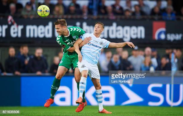Kenneth Emil Petersen of OB Odense and Andre Riel of FC Helsingor compete for the ball during the Danish Alka Superliga match between FC Helsingor...
