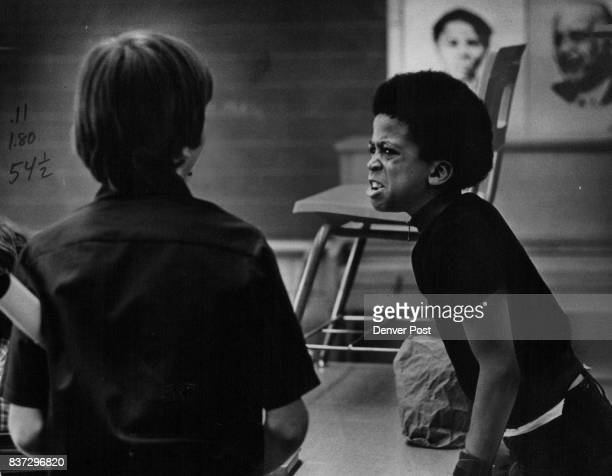 Kenneth exchanges angry words with another student but moments later the argument was forgotten and they were friends again 'When they have fights...