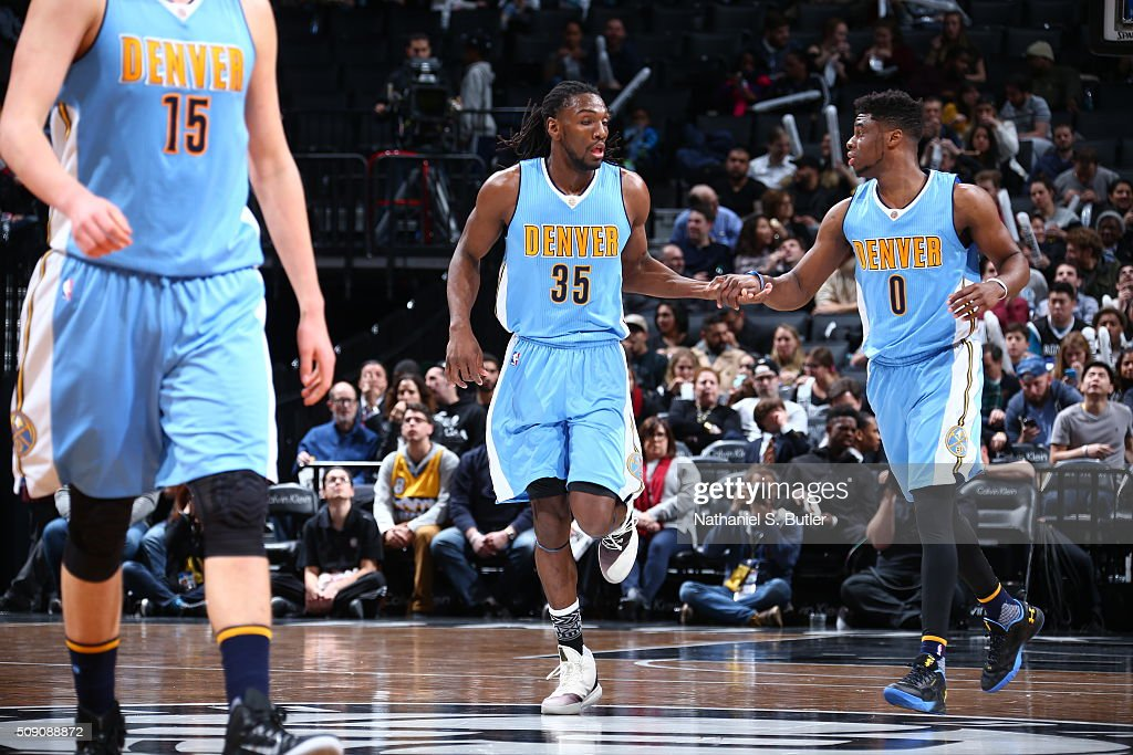 <a gi-track='captionPersonalityLinkClicked' href=/galleries/search?phrase=Kenneth+Faried&family=editorial&specificpeople=5765135 ng-click='$event.stopPropagation()'>Kenneth Faried</a> #35 and <a gi-track='captionPersonalityLinkClicked' href=/galleries/search?phrase=Emmanuel+Mudiay&family=editorial&specificpeople=9510824 ng-click='$event.stopPropagation()'>Emmanuel Mudiay</a> #0 of the Denver Nuggets high fives during the game against the Brooklyn Nets on February 8, 2016 at Barclays Center in Brooklyn, New York.