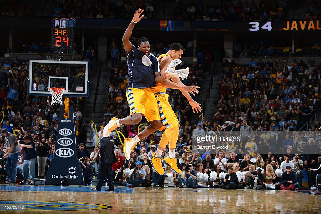 Kenneth Faried and JaVale McGee of the Denver Nuggets celebrate during the game against the Detroit Pistons on November 6 2012 at the Pepsi Center in...