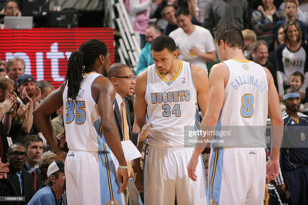 <a gi-track='captionPersonalityLinkClicked' href=/galleries/search?phrase=Kenneth+Faried&family=editorial&specificpeople=5765135 ng-click='$event.stopPropagation()'>Kenneth Faried</a> #35, Assistant Coach Melvin Hunt, <a gi-track='captionPersonalityLinkClicked' href=/galleries/search?phrase=JaVale+McGee&family=editorial&specificpeople=4195625 ng-click='$event.stopPropagation()'>JaVale McGee</a> #34, <a gi-track='captionPersonalityLinkClicked' href=/galleries/search?phrase=Danilo+Gallinari&family=editorial&specificpeople=4644476 ng-click='$event.stopPropagation()'>Danilo Gallinari</a> #8, all of the Denver Nuggets gather during a timeout against the Utah Jazz at Energy Solutions Arena on November 26, 2012 in Salt Lake City, Utah.