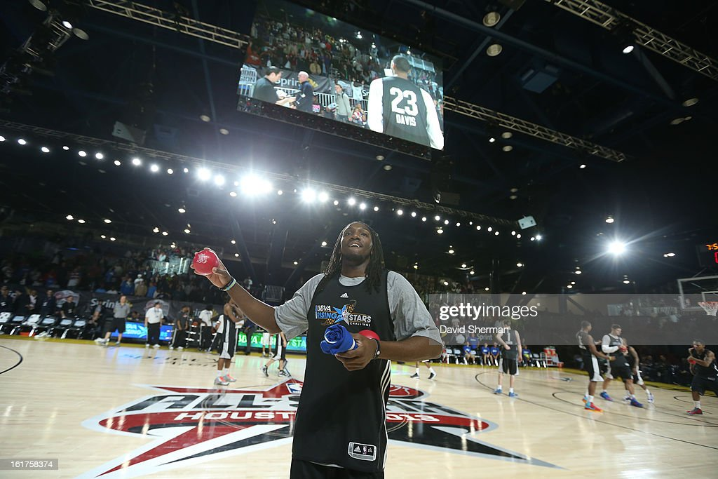 Kenneth Faried of Team Chuck tosses t-shirts after the BBVA Rising Stars Challenge Practice in Sprint Arena during the 2013 NBA Jam Session on February 15, 2013 at the George R. Brown Convention Center in Houston, Texas.