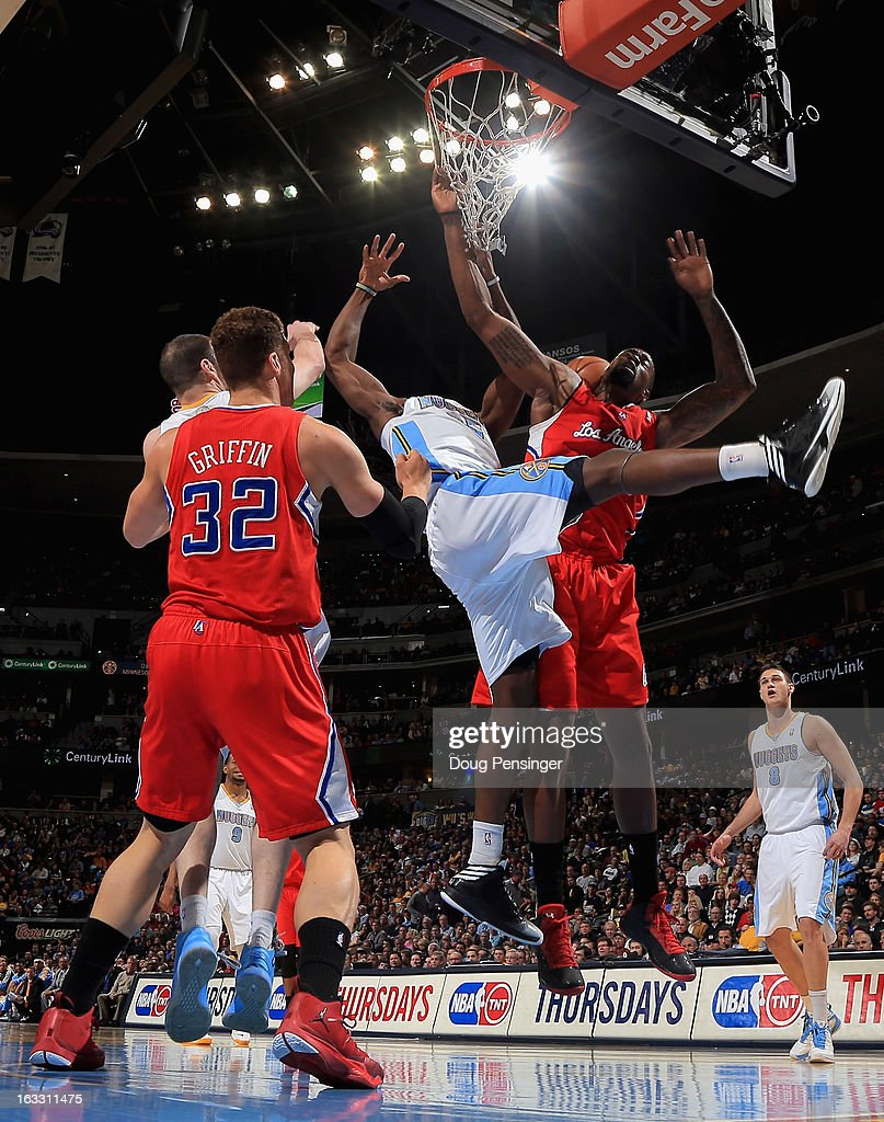 Kenneth Faried #35 of the Denver Nuggets and DeAndre Jordan #6 of the Los Angeles Clippers battle for a rebound at the Pepsi Center on March 7, 2013 in Denver, Colorado.