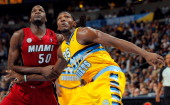 Kenneth Faried of the Denver Nuggets and Joel Anthony of the Miami Heat battle for position at the Pepsi Center on November 15 2012 in Denver...