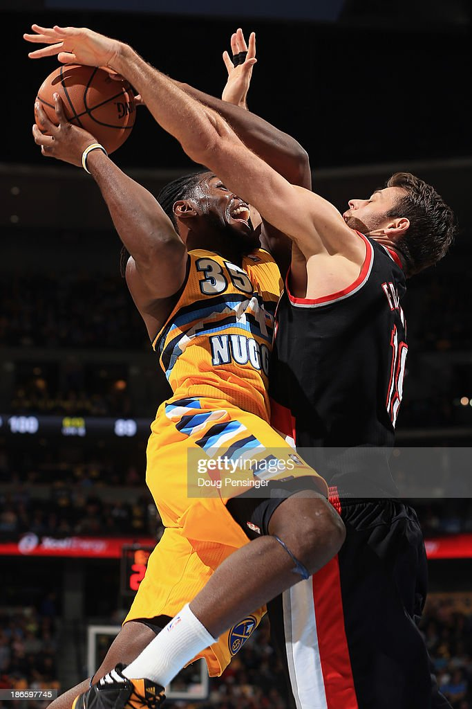 <a gi-track='captionPersonalityLinkClicked' href=/galleries/search?phrase=Kenneth+Faried&family=editorial&specificpeople=5765135 ng-click='$event.stopPropagation()'>Kenneth Faried</a> #35 of the Denver Nuggets attempts a shot and is fouled by <a gi-track='captionPersonalityLinkClicked' href=/galleries/search?phrase=Joel+Freeland&family=editorial&specificpeople=757235 ng-click='$event.stopPropagation()'>Joel Freeland</a> #19 of the Portland Trail Blazers at Pepsi Center on November 1, 2013 in Denver, Colorado. The Trail Blazers defeated the Nuggets 113-98.