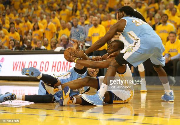 Kenneth Faried of the Denver Nuggets battles for the ball with Carl Landry of the Golden State Warriors during Game Six of the Western Conference...