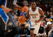 Kenneth Faried of the Denver Nuggets controls the ball against the Orlando Magic at Pepsi Center on January 7 2015 in Denver Colorado The Nuggets...