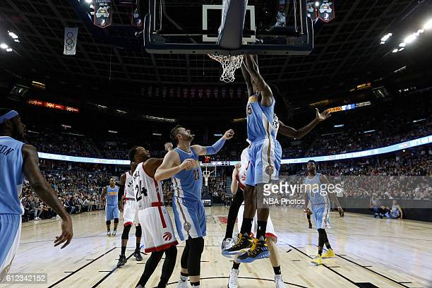 Kenneth Faried of the Denver Nuggets da the Toronto Raptors on October 3 2016 at the Scotiabank Saddledome in Calagary Alberta Canada NOTE TO USER...