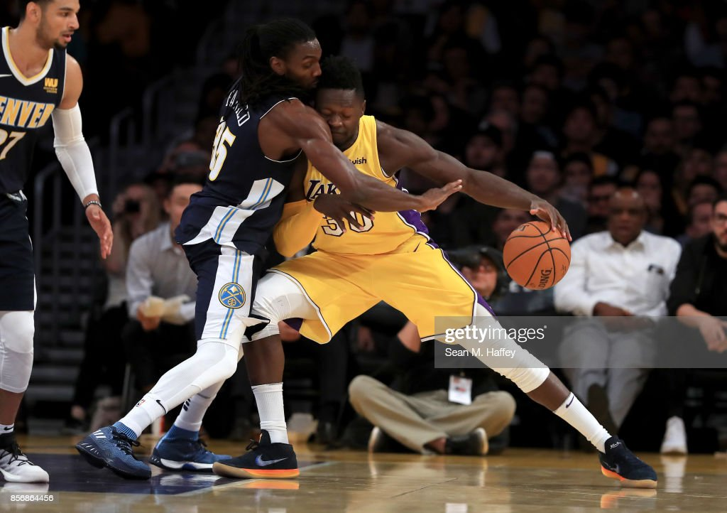 Kenneth Faried #35 of the Denver Nuggets defends against Julius Randle #30 of the Los Angeles Lakers during the first half of a preseason game at Staples Center on October 2, 2017 in Los Angeles, California.