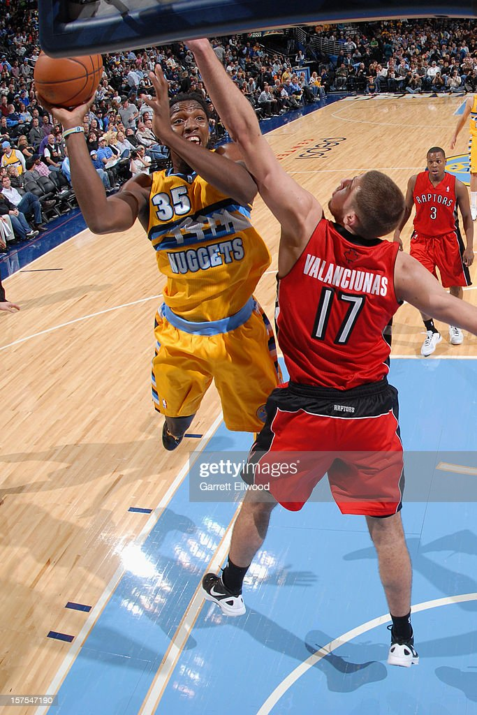Kenneth Faried #35 of the Denver Nuggets drives to the basket against Jonas Valanciunas #17 of the Toronto Raptors on December 3, 2012 at the Pepsi Center in Denver, Colorado.
