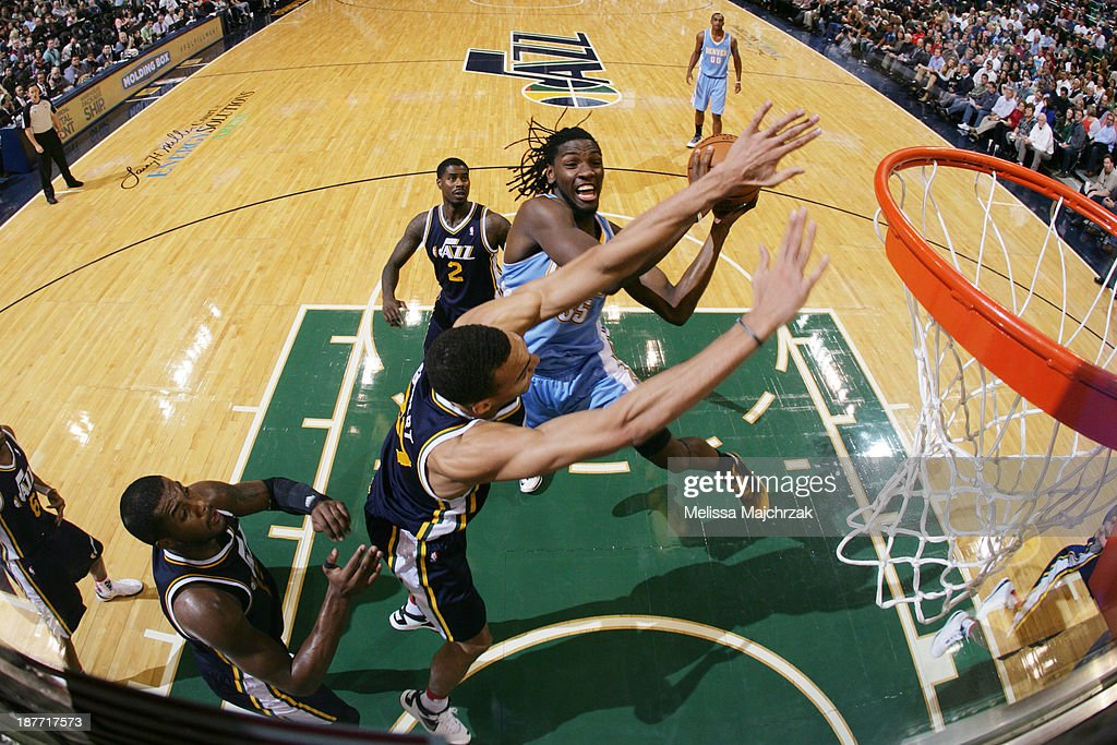 <a gi-track='captionPersonalityLinkClicked' href=/galleries/search?phrase=Kenneth+Faried&family=editorial&specificpeople=5765135 ng-click='$event.stopPropagation()'>Kenneth Faried</a> #35 of the Denver Nuggets drives to the basket against Rudy Golbert #27 of the Utah Jazz at EnergySolutions Arena on November 11, 2013 in Salt Lake City, Utah.