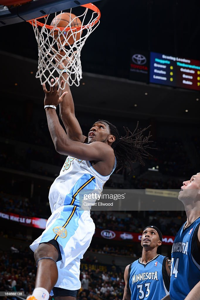 <a gi-track='captionPersonalityLinkClicked' href=/galleries/search?phrase=Kenneth+Faried&family=editorial&specificpeople=5765135 ng-click='$event.stopPropagation()'>Kenneth Faried</a> #35 of the Denver Nuggets drives to the basket against the Minnesota Timberwolves on March 9, 2013 at the Pepsi Center in Denver, Colorado.