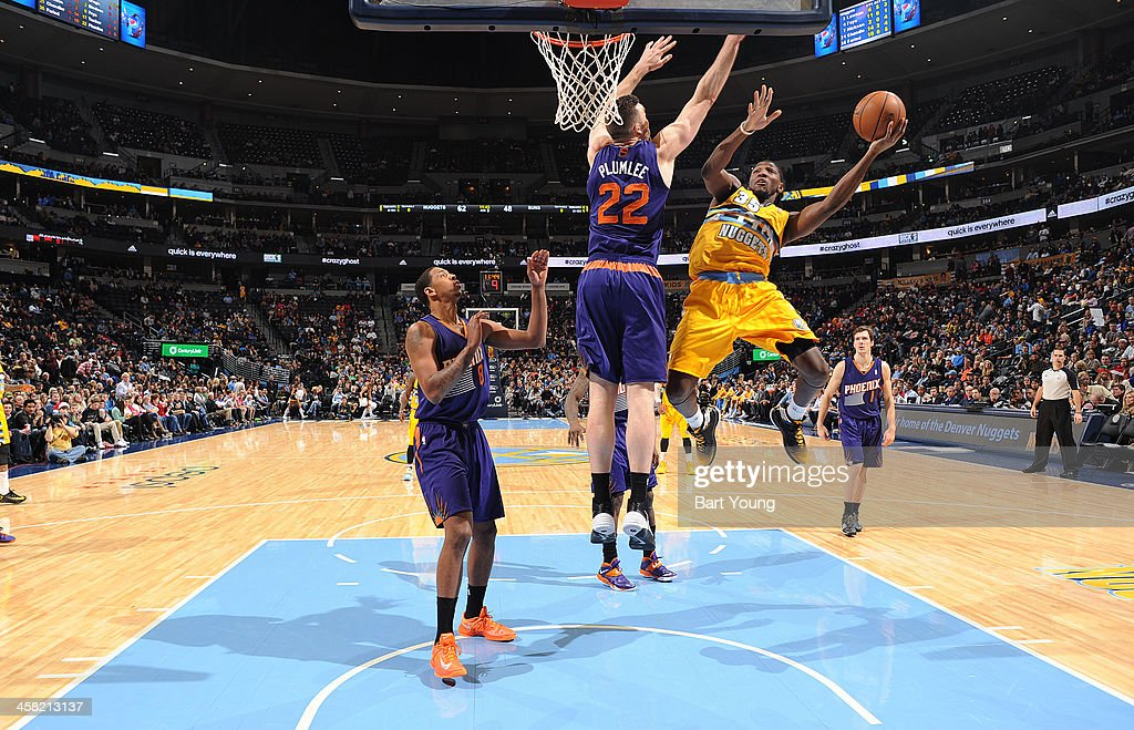 <a gi-track='captionPersonalityLinkClicked' href=/galleries/search?phrase=Kenneth+Faried&family=editorial&specificpeople=5765135 ng-click='$event.stopPropagation()'>Kenneth Faried</a> #35 of the Denver Nuggets drives to the basket against the Phoenix Suns on December 20, 2013 at the Pepsi Center in Denver, Colorado.