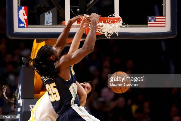 Kenneth Faried of the Denver Nuggets dunks on Omri Casspi of the Golden State Warriors at the Pepsi Center on November 4 2017 in Denver Colorado NOTE...