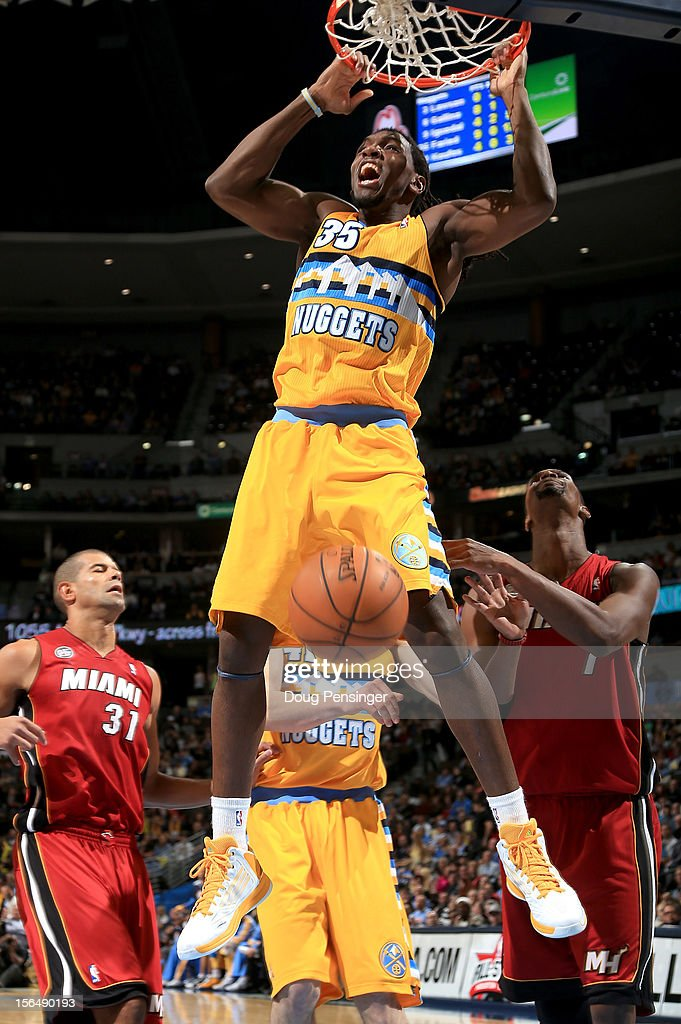 Kenneth Faried #35 of the Denver Nuggets dunks the ball against Chris Bosh #1 of the Miami Heat at the Pepsi Center on November 15, 2012 in Denver, Colorado. The Heat defeated the Nuggets 98-93.