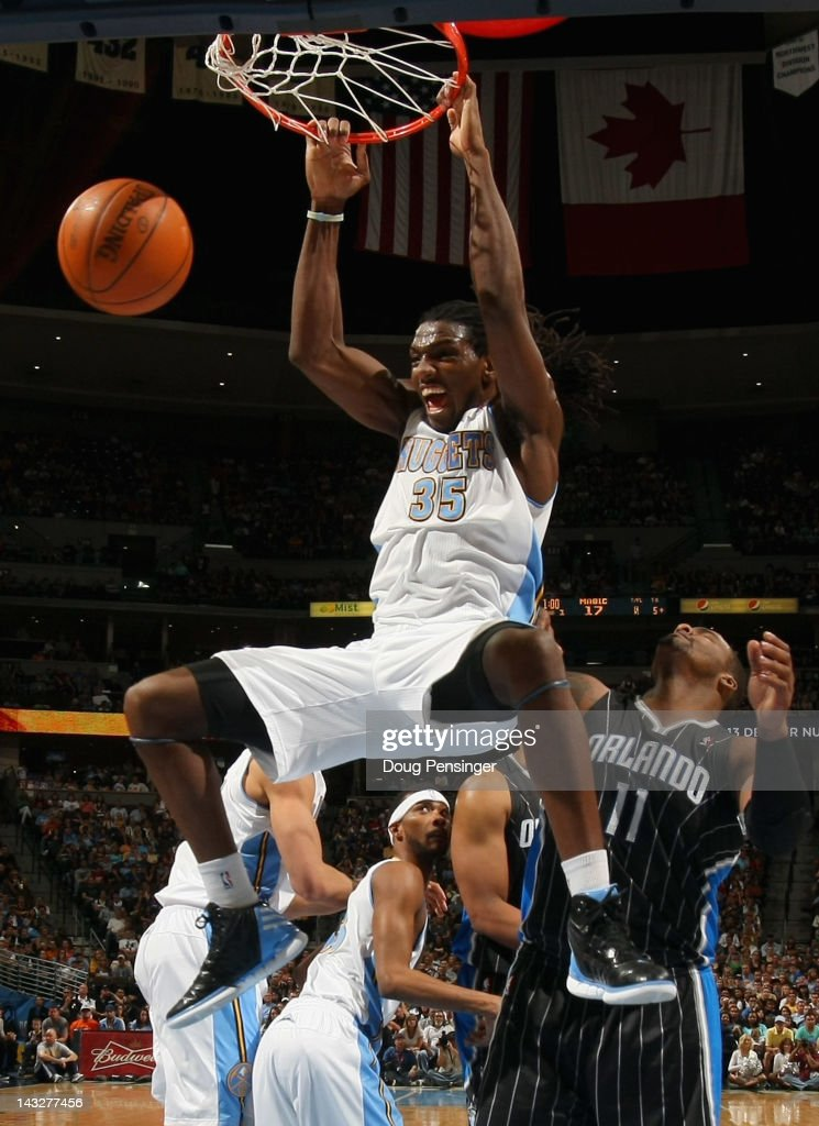 <a gi-track='captionPersonalityLinkClicked' href=/galleries/search?phrase=Kenneth+Faried&family=editorial&specificpeople=5765135 ng-click='$event.stopPropagation()'>Kenneth Faried</a> #35 of the Denver Nuggets dunks the ball against <a gi-track='captionPersonalityLinkClicked' href=/galleries/search?phrase=Glen+Davis+-+Basketball+Player&family=editorial&specificpeople=709385 ng-click='$event.stopPropagation()'>Glen Davis</a> #11 of the Orlando Magic at Pepsi Center on April 22, 2012 in Denver, Colorado.