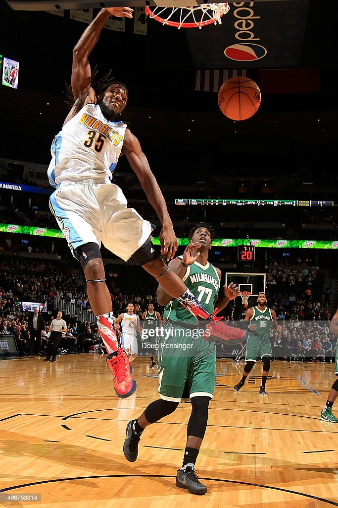 <a gi-track='captionPersonalityLinkClicked' href=/galleries/search?phrase=Kenneth+Faried&family=editorial&specificpeople=5765135 ng-click='$event.stopPropagation()'>Kenneth Faried</a> #35 of the Denver Nuggets dunks the ball against <a gi-track='captionPersonalityLinkClicked' href=/galleries/search?phrase=Johnny+O%27Bryant+III&family=editorial&specificpeople=7621234 ng-click='$event.stopPropagation()'>Johnny O'Bryant III</a> #77 of the Milwaukee Bucks at Pepsi Center on November 11, 2015 in Denver, Colorado. The Nuggets defeated the Bucks 103-102.