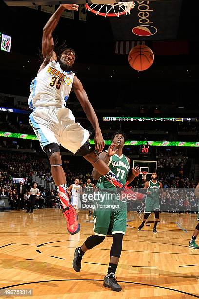 Kenneth Faried of the Denver Nuggets dunks the ball against Johnny O'Bryant III of the Milwaukee Bucks at Pepsi Center on November 11 2015 in Denver...