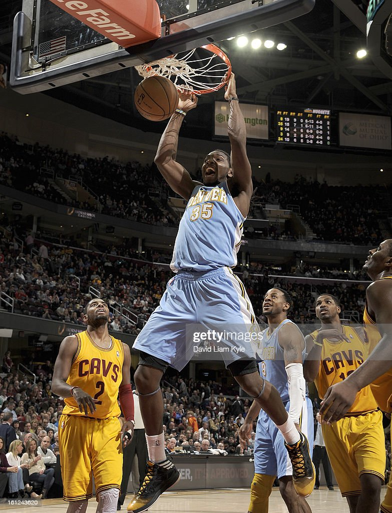 Kenneth Faried #35 of the Denver Nuggets dunks the ball against Kyrie Irving #2 of the Cleveland Cavaliers at The Quicken Loans Arena on February 9, 2013 in Cleveland, Ohio.
