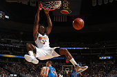 Kenneth Faried of the Denver Nuggets dunks the ball against the Dallas Mavericks at Pepsi Center on March 6 2016 in Denver Colorado NOTE TO USER User...
