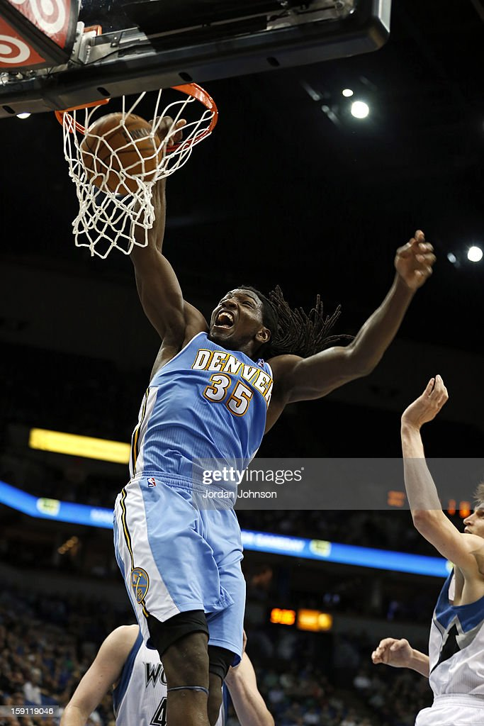 <a gi-track='captionPersonalityLinkClicked' href=/galleries/search?phrase=Kenneth+Faried&family=editorial&specificpeople=5765135 ng-click='$event.stopPropagation()'>Kenneth Faried</a> #35 of the Denver Nuggets dunks the ball against the Minnesota Timberwolves on November 21, 2012 at Target Center in Minneapolis, Minnesota.
