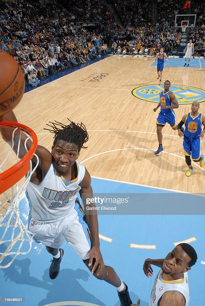 <a gi-track='captionPersonalityLinkClicked' href=/galleries/search?phrase=Kenneth+Faried&family=editorial&specificpeople=5765135 ng-click='$event.stopPropagation()'>Kenneth Faried</a> #35 of the Denver Nuggets dunks the ball against the Golden State Warriors on January 13, 2013 at the Pepsi Center in Denver, Colorado.
